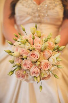 Bride's Hand Tied Bouquet consisting of pale pink sweet avalanche roses and white lisianthus. Flowers by Joanna Carter, UK.