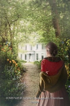 Trevillion Images - woman-in-shawl-on-path-to-country-house