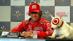 Just another day in the life of Bullseye the dog! May 2012 press conference with Dario Franchitti.