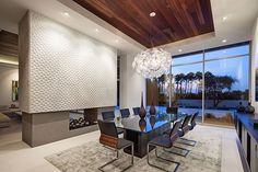 A floating fireplace wall divides the living and dining rooms. Source: The Agency Salas Lounge, Floating Fireplace, Modern Fireplace, Fireplace Wall, Plafond Design, Modern Mansion, Modern Homes, Decoration Inspiration, Decor Ideas