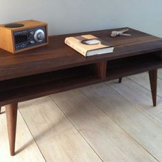Nice Mid Century Modern Coffee Table, Black Walnut With Tapered Wood Legs.