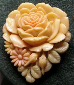 Vintage Bakelite Celluloid Clip Pin/ Brooch Marking on back Japan this is a lovely piece colors are Light yellow - light red or pink and light green ...  #bakelite #carved #celluloid #cream #flowers #peach #rose #vintage #jewelry
