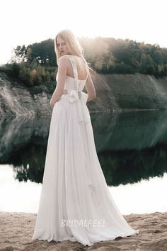 A line floor length informal wedding dress in with a decorated sleeveless lace bodice and a falling chiffon skirt.