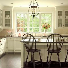 Cabinets with simple beaded molding around a flat inset panel are nearly style-neutral