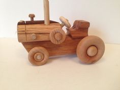 Wooden Farm Tractor Toy is Handcrafted from 100% Wood. (No Nails or Metal) This simple & cute little wooden Farm Tractor is perfect size for