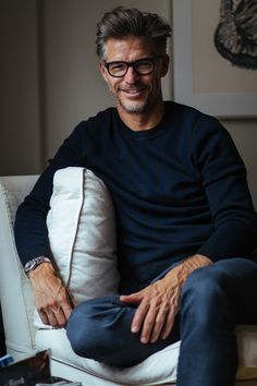 Sweater by Sandro, Pants by J Crew, Watch by Rolex, Glasses by Tom Ford.