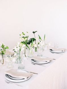 Minimal neutral tablescape for Wedding. Greenery.