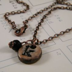 This is cute Karen....Rustic relic initial personalized necklace copper finish From Helium Studio on Etsy.