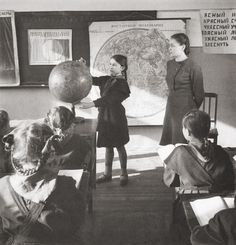 Geography lessons in a USSR school, 1951   Photographer: Yevgeny Khaldei, USSR