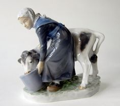 Vintage Royal Copenhagen Figurine Girl with Calf by NothernAntique, $169.00. This was our wedding gift from Danola.