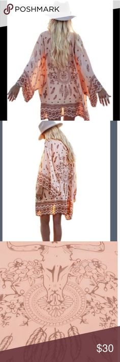 "Boho Kimono Adorable Bohemian Style Kimono!! Wear as a coverup or wear out and either way it will look Gorgeous! Color is a pink/peach Available in S,M Measures 31"" Length and 13"" sleeves 1/2 sleeve. Discounts on a Bundle ..Size Large shown in picture. Swim Coverups"