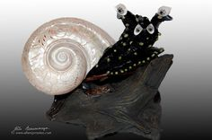 """""""Snail"""", seashell and drift wood sculpture, modern statue, interior nautical decor."""