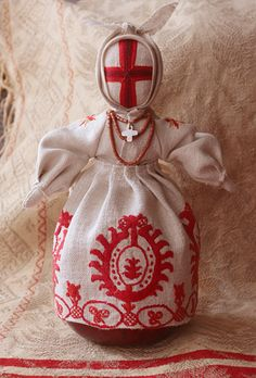 A traditional Ukranian motanka doll.    Motanka dolls are traditional Ukrainian dolls made of scraps of cloth with colorful ribbon and thread.