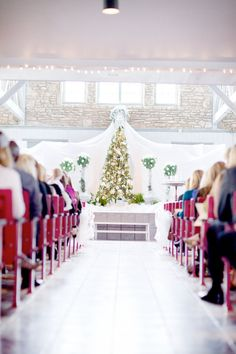 An amazing christmas isle. This is perfection down to the red chairs! Photography by glassjarphotography.com