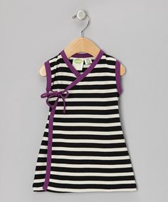 Dress little ladies in socially conscious clothes that are kind to the world without sacrificing style. This fair-trade organic cotton frock has a unique wrap silhouette paired with contrasting colors for a look that's as sweet as the lovebug wearing it.