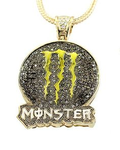 """Monster Energy Drink 3"""" X 2"""" Charm Pendant Gunmetal Black with White Crystal Gold Tone Franco Chain Men Necklaces. $36.95. 32"""" Gold Tone Franco Chain. Pendant about 3"""" X 2"""". White Crystal. Monster Energy Drink Gunmetal Black Pendant. Nickel & Lead Free"""
