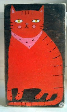 orange cat on stained wood by oswald flump, via Flickr