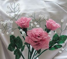Hand made french beaded flowers.