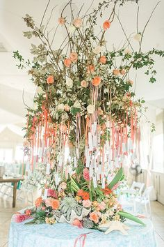 Gorgeous beach wedding escort card tree idea with hanging cards on peach ombre ribbons surrounded by starfish, shells, and flowers Modern Wedding Flowers, Beach Wedding Flowers, Wedding Reception Decorations, Beach Wedding Reception, Wedding Seating, Beach Weddings, Orange Wedding, Flower Decorations, Spring Decorations