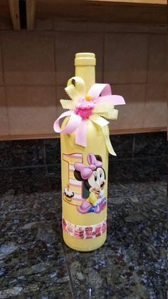 Disneys baby Minnie Mouse turns one! This makes a great gify for that special little girls birthday! This is a painted upcycled wine bottle with ribbons and resin to match. Makes a great gift, decoration and perfect addition to your Disney Collection