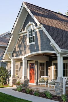 I like how the front leans over a porch at ground level.. cool variation of the craftsman bungalow