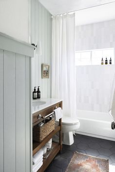 Bright and airy English cottage style bathroom with modern lighting Shower Plumbing, Tub And Shower Faucets, Best Bathroom Paint Colors, Guest Bathroom Colors, White Bathroom Paint, Colorful Bathroom, Blue Green Bathrooms, Cottage Style Bathrooms, Cottage Style Showers