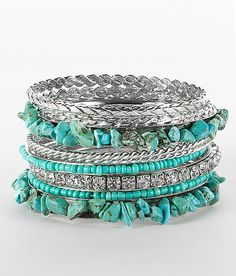 I like this layered look with the silver bangles and turquoise stones.