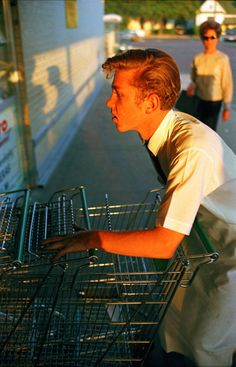 William Eggleston, From Los Alamos Folio 1, Memphis, (supermarket boy with carts), 1965