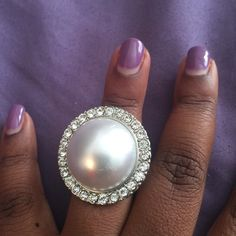 Pearl and rhinestone ring Large pearl like stone surrounded by rhinestones in a silver expandable setting Jewelry Rings