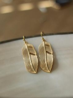 FINE FEATHER EARRINGS @Melodie Updike    :) I'll get them for you net year!