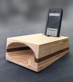 Portable, powerful and made from natural material, this phone speaker projects the sound from your smartphone without the use of cords, batteries or a digital connection. Baltic birch plywood and a contrasting layer of walnut or mahogany are smoothed into an angled wedge shape, hollowed with a uniquely curved acoustic cone, amplifying sound with a warm, full tone.