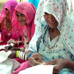 Indian women embroidering.