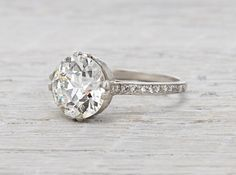 Art Deco vintage engagement ring made in platinum and centered with an approximate 3.77 carat EGL certified old European cut diamond with H color and VS2 clarity. Accented with single cut diamonds on