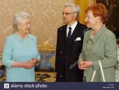 Britain's Queen Elizabeth II (L) greets Finland's President Tarja Halonen (R) and her husband Dr Pentti Arajarvi Stock Photo