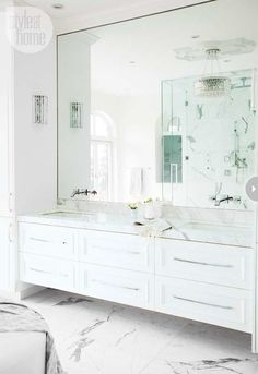 Bathroom with a marble floating vanity designed by The Cross Design, via @sarahsarna.