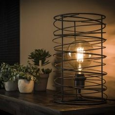 This table lamp is a single pendant designed in a cylinder shaped spiral. This spiral shape gives a playfull effect in your interior. The tabel lamp is finished in a dark charcoal colour. Industrial Floor Lamps, Industrial Ceiling Lights, Industrial Living, Industrial Table, Retro Lampe, Flur Design, Tourbillon, Hallway Designs, Led Lampe