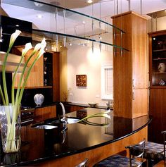 Glass Details, Breakfast Bar and Black Appliances Contemporary Kitchen Photos Pictures