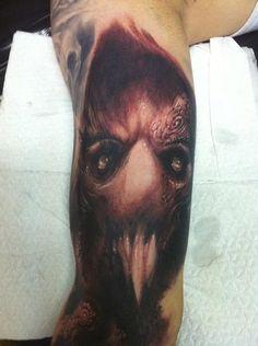 Evil face tattoo