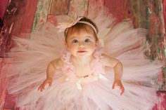 Isn't this perfect for a 1st Birthday pics?    http://www.etsy.com/listing/94707628/light-pink-and-ivory-tea-rose-tutu-dress