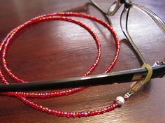 Pearlescent Coated Red Eyeglass Beaded Chain, Glasses chain, Reading Glasses chain, Beaded glasses chain. https://www.etsy.com/listing/213728780/pearlescent-coated-red-eyeglass-beaded?ref=related-2&utm_content=buffer36589&utm_medium=social&utm_source=twitter.com&utm_campaign=buffer