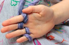 Kid Craft: How to Finger Knit an Infinity Scarf | http://hellonatural.co/diy-finger-knit-infinity-scarf/