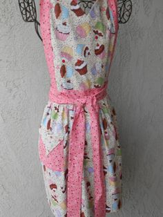 Cupcakes anyone gathered skirt on this reversible apron with pink accents and sprinkles, flattering neckline by judarose on Etsy