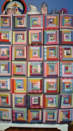 Deb Rowden's Thrift Shop Quilts - this quilt is made by Rosie Mayhew out of her collection of thrift store shirts - her wonky log cabin.