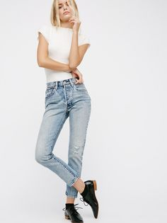 501 Skinny Jeans | The iconic Levi's 501 has been reimagined with a slimmer skinny leg that has been cropped to graze just above the ankle. * Fits straight through the hip and thigh. * Will retain its shape overtime. * Non-stretch denim. * Five-pocket style. * Button fly.