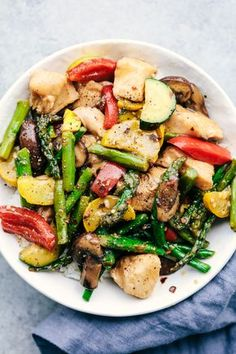 The best part about one-pan meals is that you can toss in all the ingredients you love - or really just whatever you have on hand in the fridge. This Honey Garlic Chicken Stir Fry uses bell pepper, asparagus, mushrooms, squash, and zucchini, but don't be afraid to improvise!