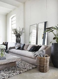 Living Room , Feng Shui In Living Room : Feng Shui In Living Room With Mirrors Behind The Sofa And Black Vases And Wicker Basket And Rustic Coffee Table And Pebble Bottom And Ceramic Floor
