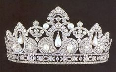 A diamond and pearl tiara. Multiple button pearls enclosed within motifs, with pear-shaped pearls hung from diamond arches, with an open-work diamond base.