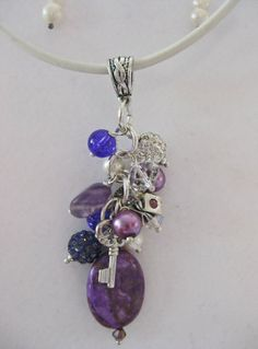 Charming purple & white semi precious stones, Mother of pearl, rhinestones, swarovski, strung on a beautiful piece of white Greek leather