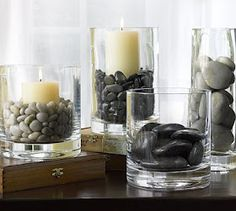 centerpiece idea if you have white linens, you could go gray stones and candles and accent with small color flower feature in between vases