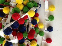 Multi coloured Pom Pom Trim. Super high quality, available now fabrictraders.com.au